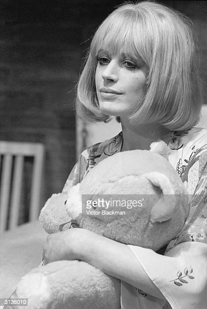 English actress and singer Marianne Faithfull clutching a teddy bear during her role in 'The Collector' at St Martin's Theatre London