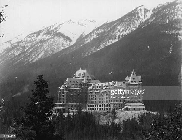 The majestic Banff Springs Hotel in the snowy mountains near Alberta in Canada one of the luxury resorts opened in 1888 by the Canadian Pacific...