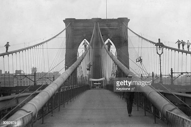 Painters give the Brooklyn Bridge its winter coat of paint Total length of the bridge is 2065 metres and it is the longest suspension bridge in the...
