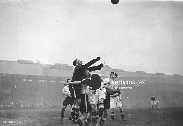 Fulham goalkeeper Turner saves from Chelsea's Hanson during their 4th Round FA Cup match at Stamford Bridge