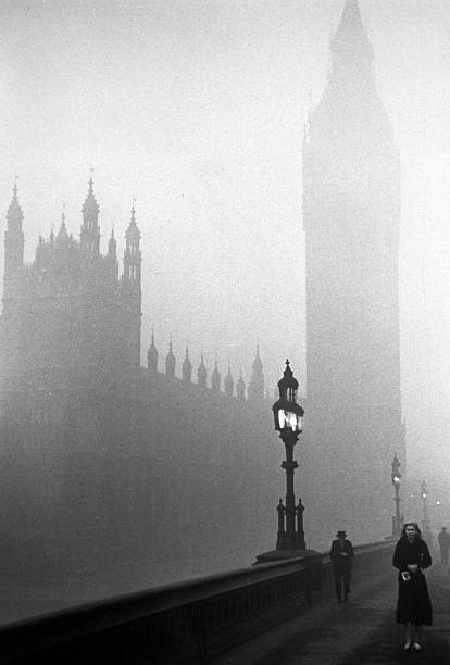 The Houses of Parliament, London, engulfed in fog....