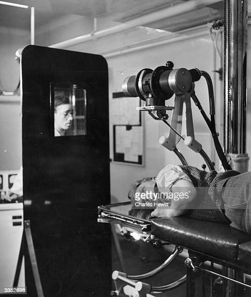 A worker is checked for exposure to radiation in the XRay laboratory at Harwell atomic research station in Oxfordshire Original Publication Picture...