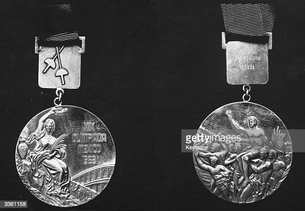 Close up of an Olympic gold medal awarded at the nineteenth games in Mexico 1968, obverse on the left reverse on the right.