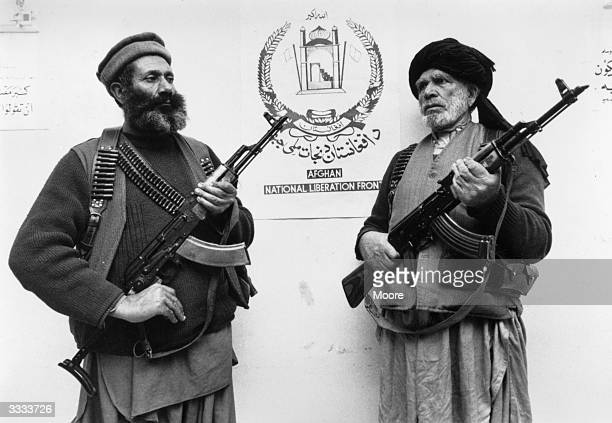 Guerillas of the Afghan National Liberation Front armed with Kalashnikov rifles at their Peshawar base during the war between Afghanistan and the USSR