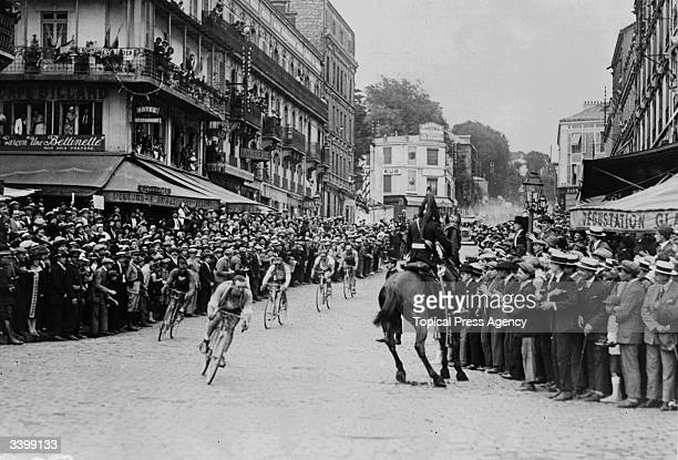 Ottavio Bottecchia of Italy chases Lucien Buysse of Belgium through St Cloud during the final stage of the 1925 Tour de France Bottecchia went on to...