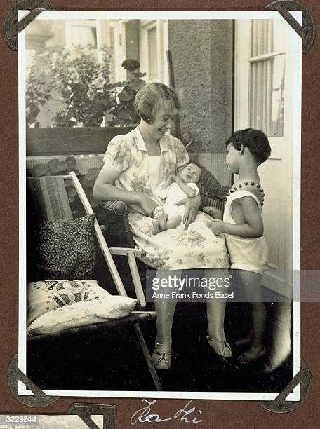 EXCLUSIVE A woman identified as Kathi from Margot Frank's photo album holding the infant Anne Frank on her lap as sister Margot Frank looks on...