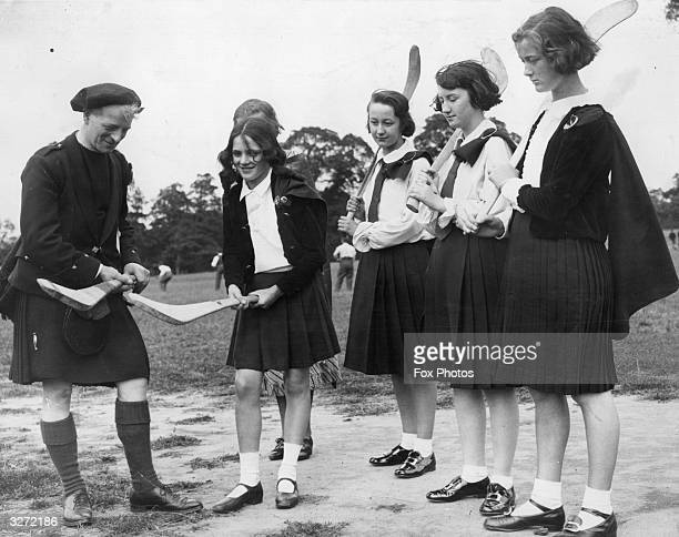 At the Irish Fair at the Gaelic Athletic Ground at Whitefoot Lane Catford south London schoolgirls are shown how to hold a hurling bat