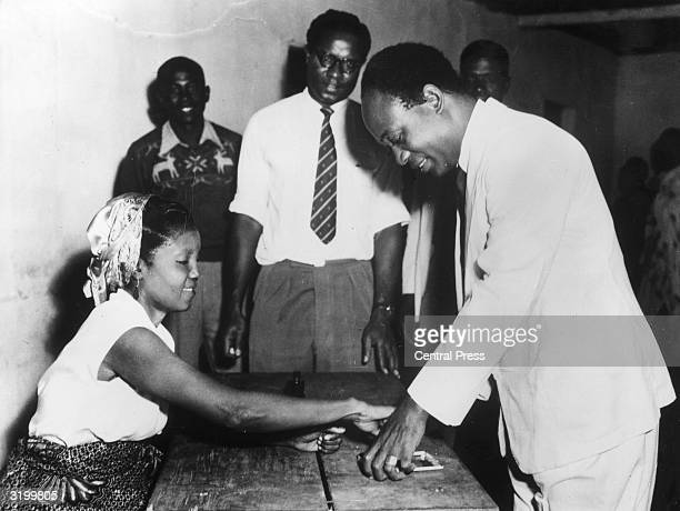 Dr Kwame Nkrumah prime minister of the Republic of Ghana having his thumb inked to guard against double voting at the Gold Coast Elections Nkrumah...