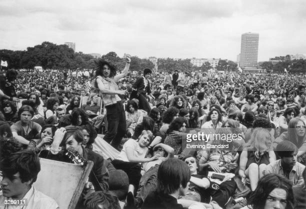 An exuberant fan at a free concert in Hyde Park performs an impromptu dance amidst the crowd