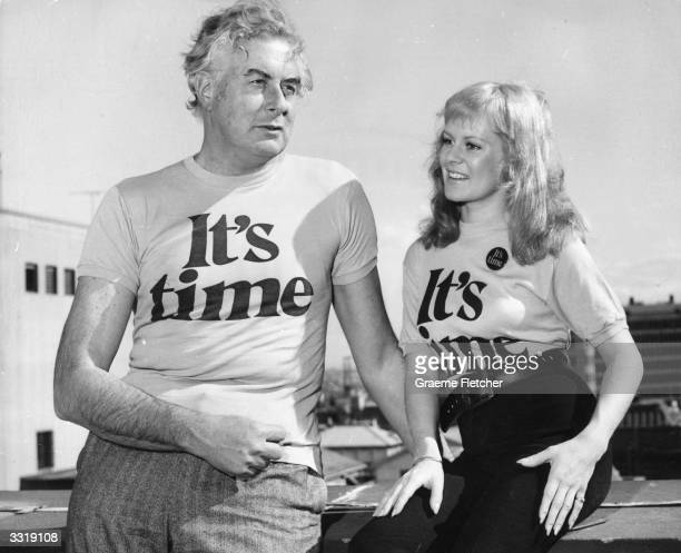 Australian politician Gough Whitlam with singer Little Pattie wearing tshirts announcing 'It's Time' for his Labour election campaign