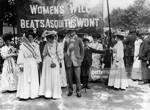 One of the seven processions to the 'Monster Meeting' in Hyde Park led by suffragettes holding a banner referring to Prime Minister Herbert Asquith