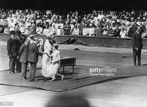 Wimbledon Champion Dorothea Lambert Chambers curtseys as she is received by King George V and Queen Mary Queen Consort at the opening ceremony for...