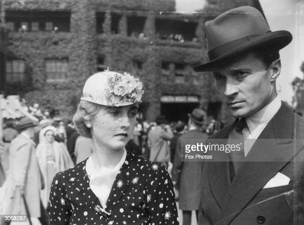 American Woolworth heiress Barbara Hutton the Countess von HaugwitzReventlow with her husband Count Kurt von HaugwitzReventlow at Wimbledon for the...