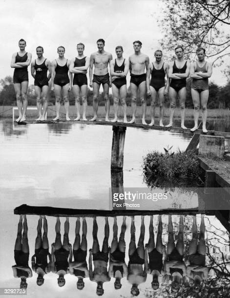 Members of the Oxford University swimming team line up on a diving board during a training session for the forthcoming intervarsity aquatic sports...