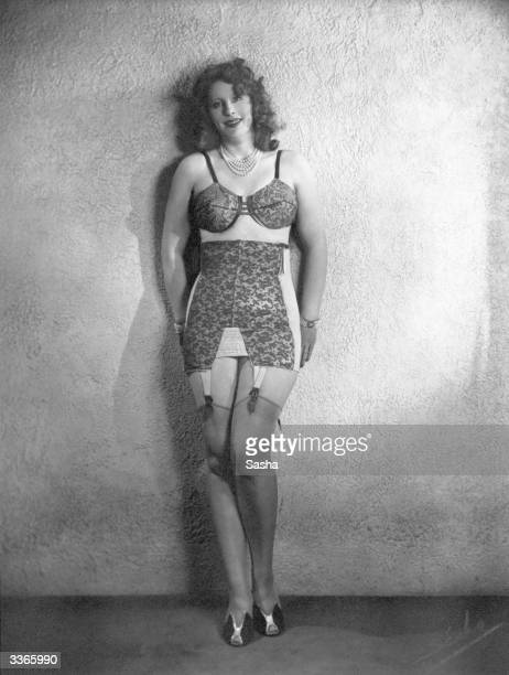 Mrs Winterbottom modelling a patterned bra and corset with attachments for her stockings