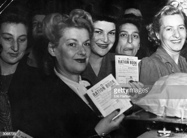 Hungry housewives bring their ration books to London's Petticoat Lane Market during World War II on the first day of bread rationing