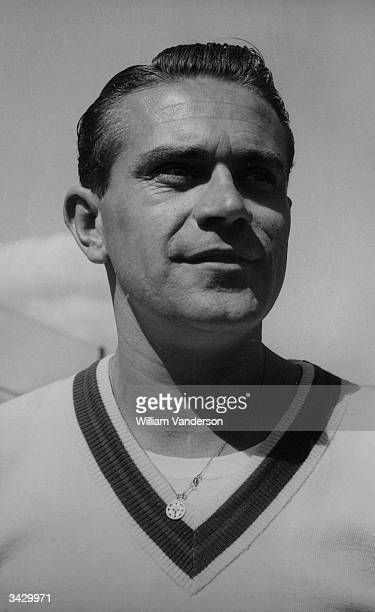 Jaroslav Drobny of CzechoSlovakia who is competing in the men's singles championship at Wimbledon He wears a lucky fourleaved clover medallion round...