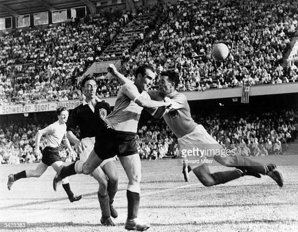 Scottish goalkeeper Martin rushes out as Uruguay's Miguez heads the ball over the bar and Scotland's Davidson tries to intercept during their World...