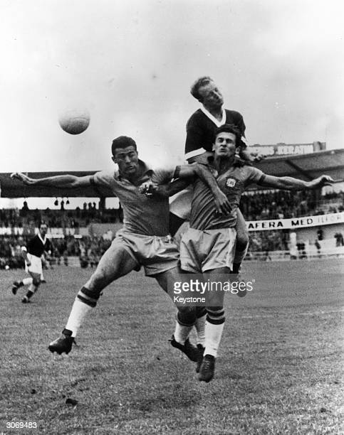 Ivor Allchurch of Wales jumping for the ball against Hideraldo Bellini and Nilton De Sordi of Brazil during their World Cup quarter final match in...