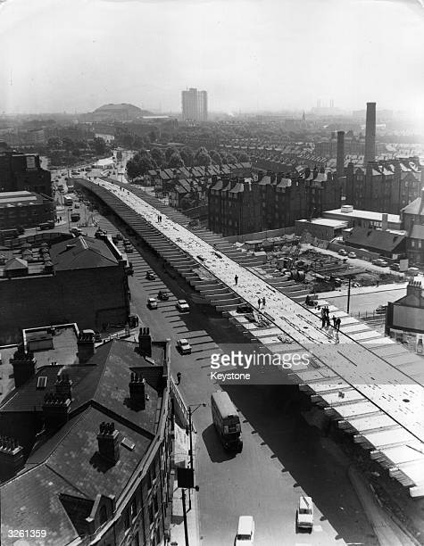 Sunlit view from the Hammersmith side showing completed installation of the final sectiont of the flyover at a cost of 1000 85 months of intensive...