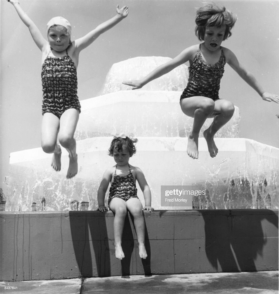 Three young girls, (from left) Wendy Greaves, Ruth Keeling and Helen Keeling at the open air swimming pool at Welwyn Garden City.