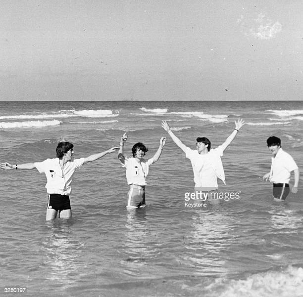 Pop group The Beatles from left to right George Harrison Ringo Starr Paul McCartney and John Lennon enjoying the Florida sea and sunshine at Miami...