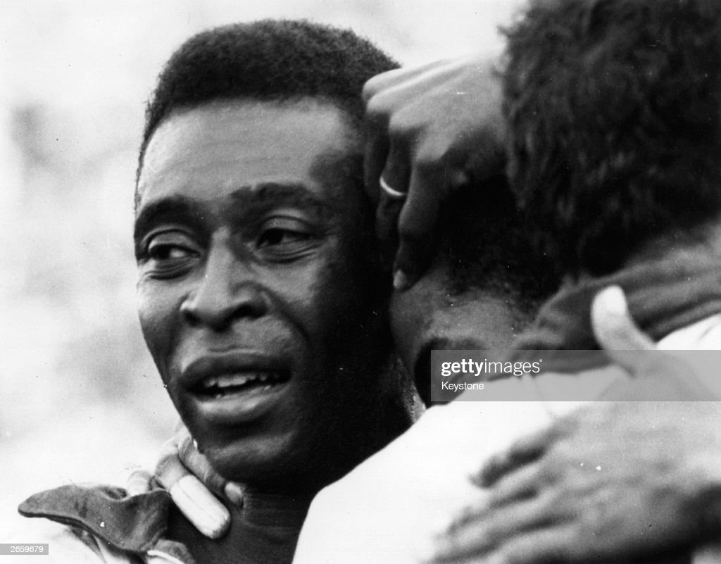 Brazilian soccer star Pele weeps with joy in the arms of his team-mates after Brazil won the FIFA World Cup at the Estadio Azteca in Mexico City, beating Italy 4-1.