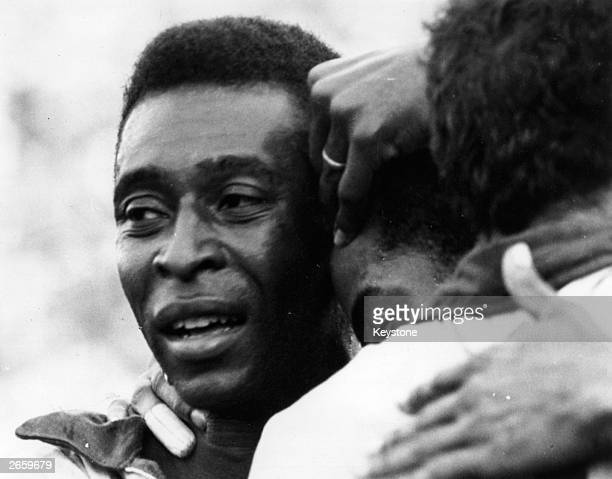Brazilian soccer star Pele weeps with joy in the arms of his teammates after Brazil won the FIFA World Cup at the Estadio Azteca in Mexico City...