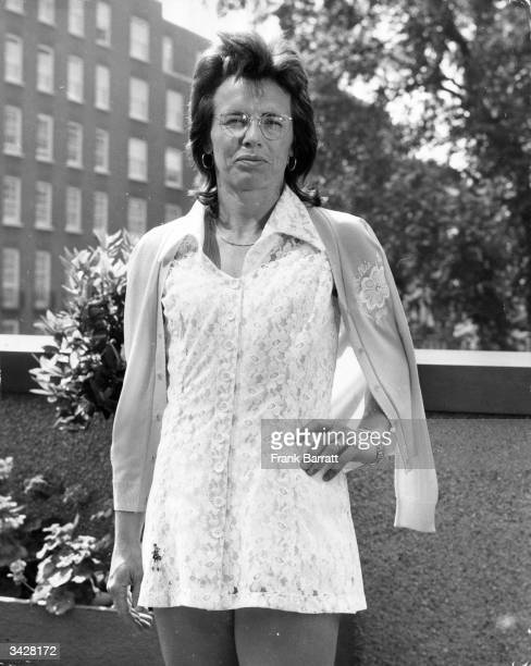 America's Billie Jean King sporting her latest Wimbledon tennis dress a white lace creation by Teddy Tingling at a prematch press photocall in...