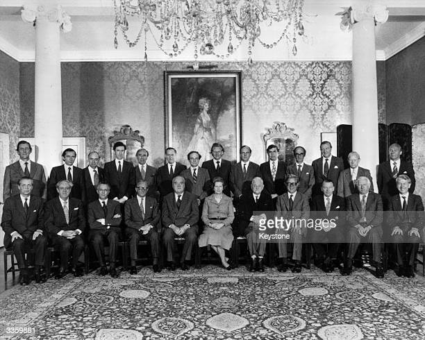 British Prime Minister Margaret Thatcher sits with her new Cabinet at No 10 Downing Street in London. Left to right : - Norman Fowler, Transport...