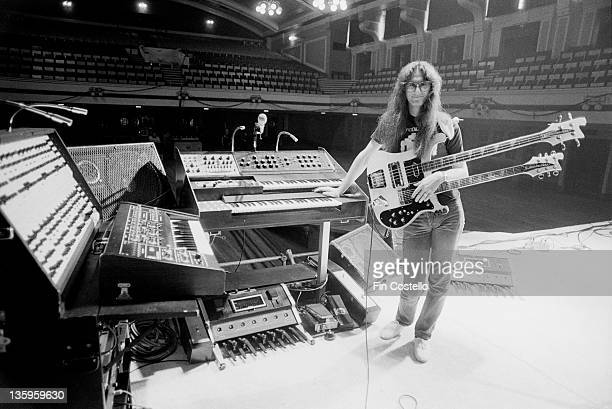 Bassist Geddy Lee of Canadian progressive rock band Rush with a doublenecked Rickenbacker guitar/bass during a soundcheck at the De Montfort Hall...