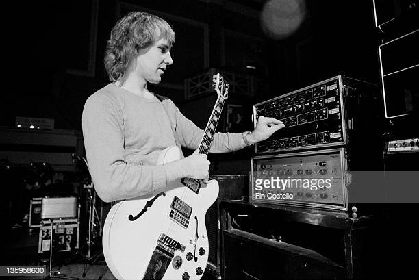 Guitarist Alex Lifeson of Canadian progressive rock band Rush adjusts levels during a soundcheck at the De Montfort Hall Leicester on 21st June 1980