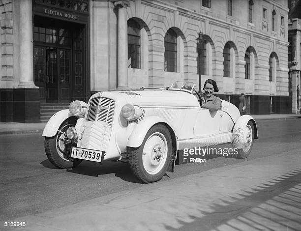 Fay Taylour in her Adler Trumpf car in which she has entered the Eastbourne Rally The car which is of German design has front wheel drive and no back...