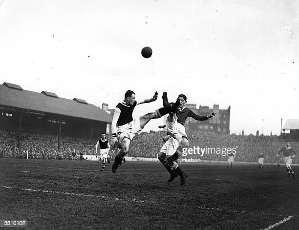 Cummings of Aston Villa and G Mills of Chelsea leap for the ball in a high kicking duel in front of the Villa goal during their match at Stamford...