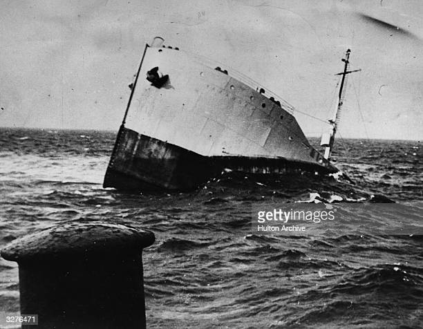An American warship sinking after an attack.