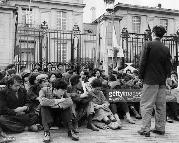 Protestors outside the gates of the British Embassy in Tokyo following the refusal of the British Government to heed Japanese pleas to halt testing...