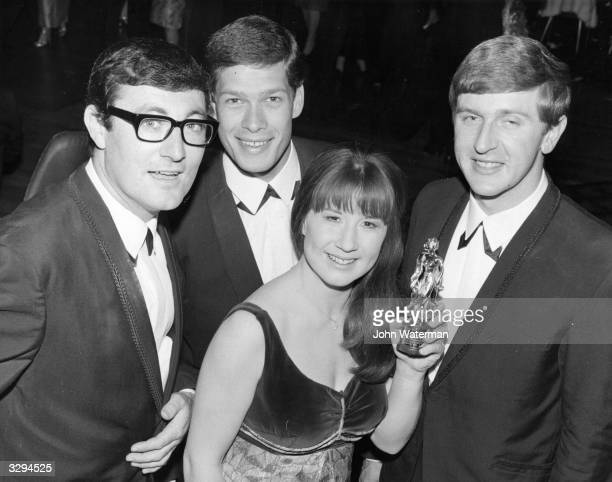 Australian pop group The Seekers brandishing their Carl Alan Award for Best New Group Of 1965, at the Empire Ballroom, Leicester Square, London. The...
