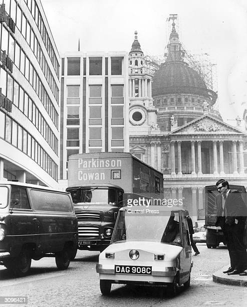 'Scamp' a batteryelectric mini car being driven down Ludgate Hill with St Paul's in the background The 'Scamp' is 7ft long has a maximum speed of...