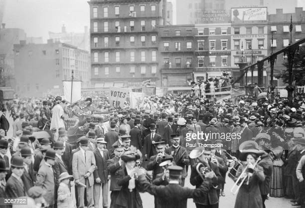 A mixed sex band playing at a rally of the League of SelfSupporting Women part of the Women's Suffrage Movement in Union Square New York