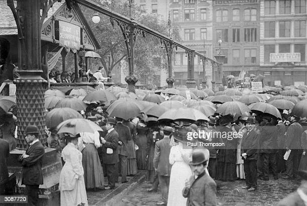 Carrie V Allen addresses the crowds at a rally of the League of SelfSupporting Women part of the Women's Suffrage Movement in Union Square New York