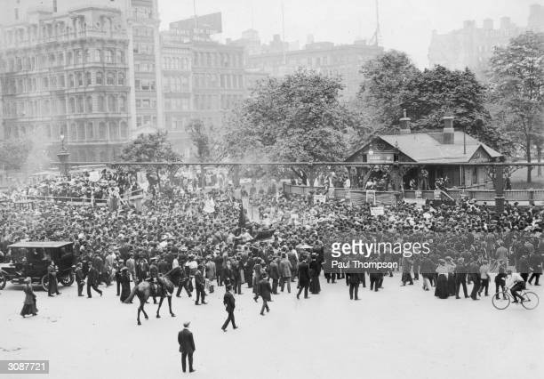 Men and women attend a rally of the League of SelfSupporting Women part of the Women's Suffrage Movement in Union Square New York