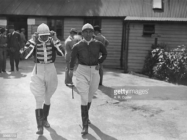 Jockeys G Armstrong who rode Farrago and Lord Carnarvon who rode Knight of Lorn to victory in the Lingfield Club Welter Stakes going to the saddling...