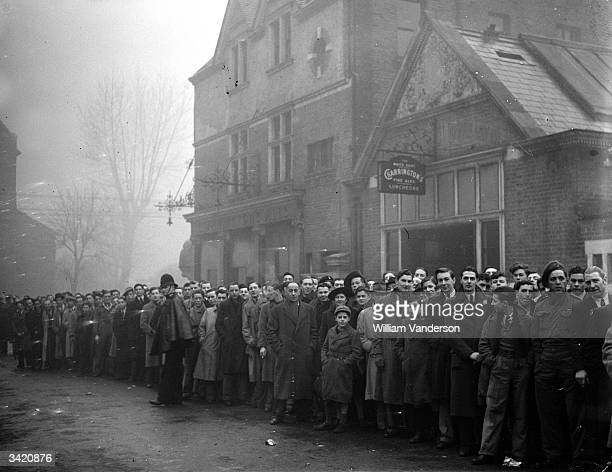 Part of the queue outside Tottenham's ground for the football match between Arsenal and Dynamo Moscow