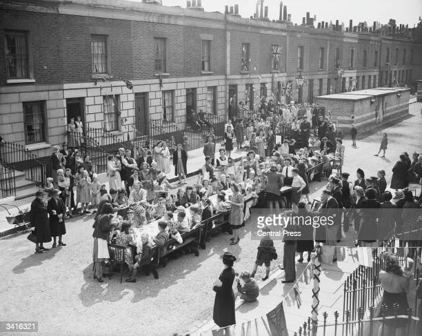 Residents of Tilloch Street in Islington London during a tea party to celebrate VE Day Decades 1940's 0745 076