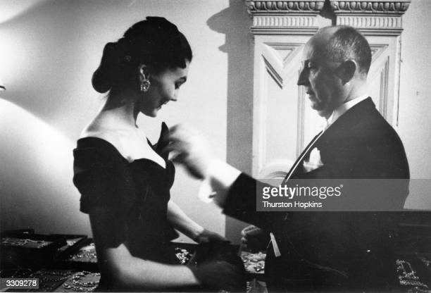 French fashion designer Christian Ernest Dior with one of his mannequins during a tour of Scotland The designer insured his collection for £60000 and...