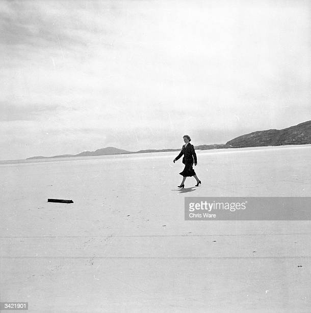 Kitty MacPherson the manageress Barra airport Britain's smallest in the Hebrides off the West Coast of Scotland She is inspecting the dry sands which...