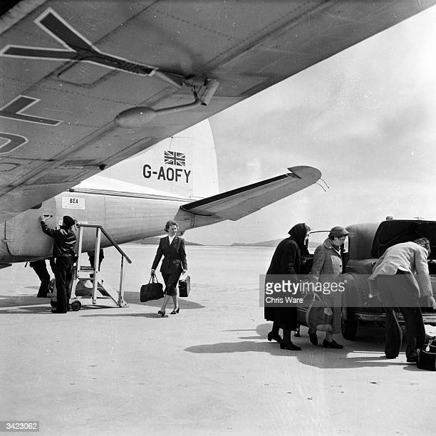 Kitty MacPherson who singlehandedly runs the airport on the tiny Hebridean island of Barra arrives on the airfield to help passengers with their...