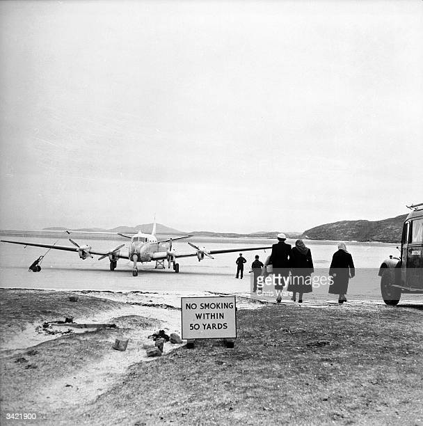 Passengers arriving at Barra airport Britain's smallest in the Hebrides off the West Coast of Scotland Barra named after St Barr is the most...