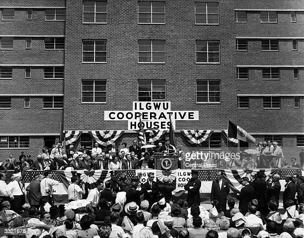 President John F Kennedy speaking at the opening ceremony of the USA's largest cooperative housing development located in the Chelsea area of...