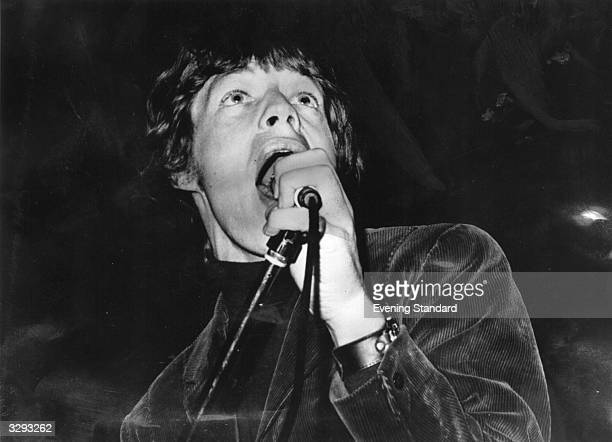 A young Mick Jagger sings on stage with the Rolling Stones